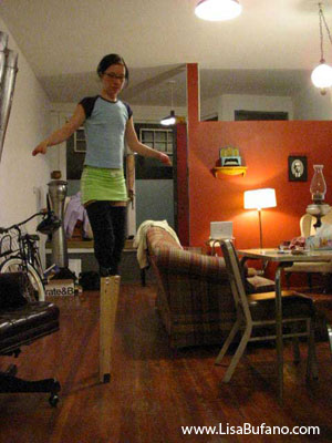 Lisa wearing an early prototype of the stilts made from wooden 2 by 4s